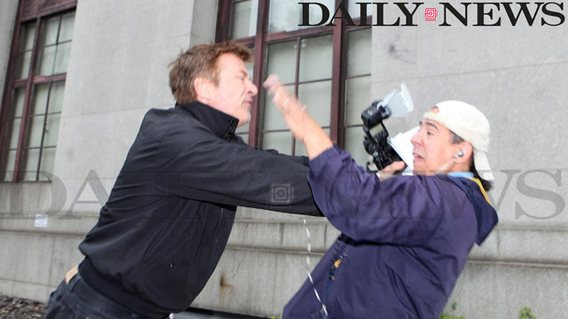 PHOTO: Alec Baldwin shoves Daily News photographer Marcus Santos after leaving the Marriage License Bureau in lower Manhattan, June 19, 2012.