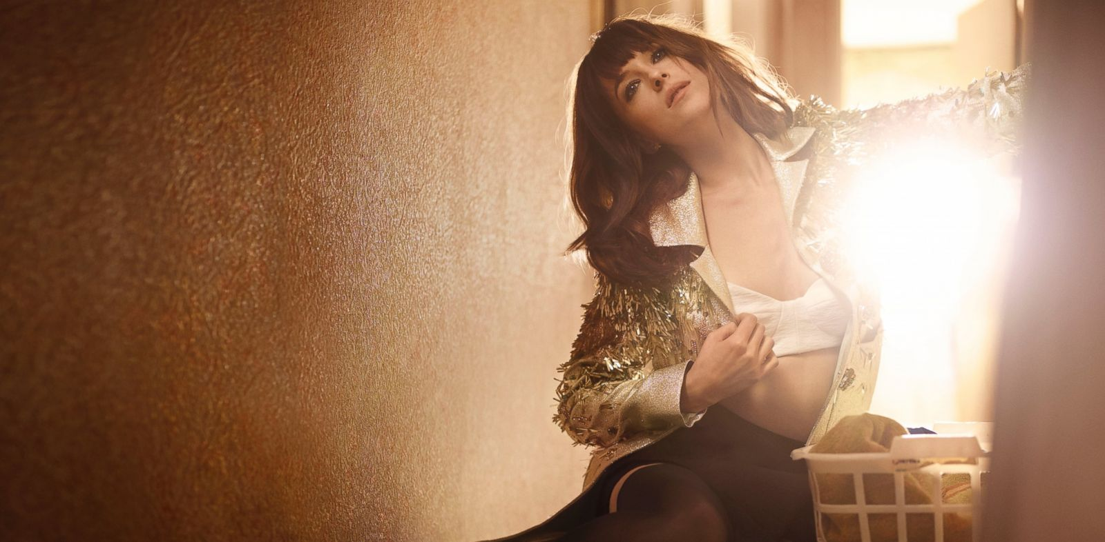 PHOTO: Dakota Johnson poses for a photo in the February issue of Elle magazine