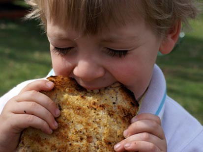 PHOTO: Erin Chases son is shown here eating grilled garlic bread.