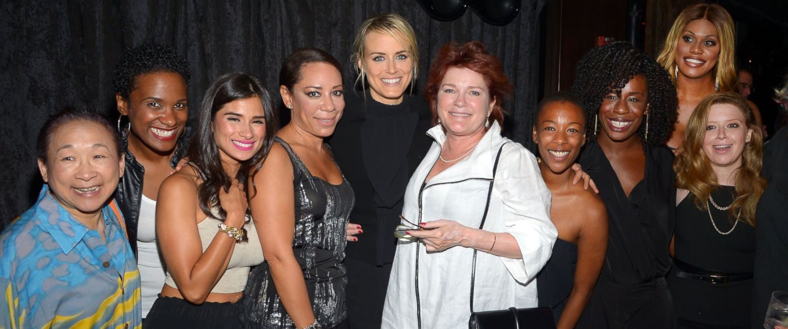"""PHOTO: Taylor Schilling celebrates her 30th birthday at CATCH Roof in New York City on July 26, 2014 with several """"Orange is the New Black"""" cast members including Kate Mulgrew, Natasha Lyonne, and Laverne Cox."""