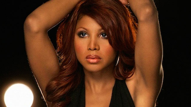 PHOTO: Toni Braxton, 45, seen here during a video shoot, recently said she was considering posing nude for Playboy to help her financial situation.