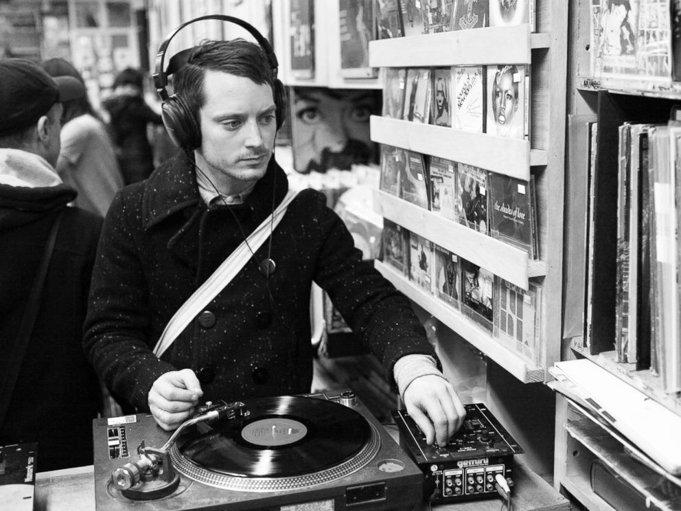 PHOTO: Elijah Wood is pictured listening to a vinyl record at A1 Records in New York City on Jan. 19, 2015.