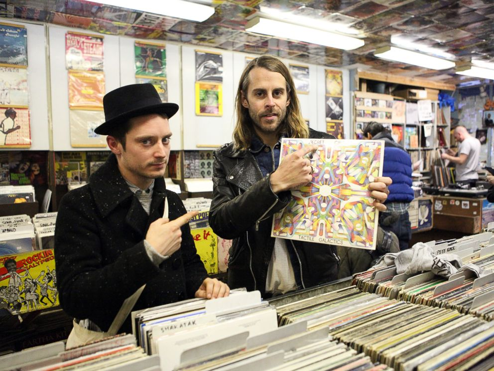 PHOTO: Elijah Wood, left, and Zach Cowie, right, present a copy of Secret Circuits album Tactile Galactics at A1 Records in New York City on Jan. 19, 2015.