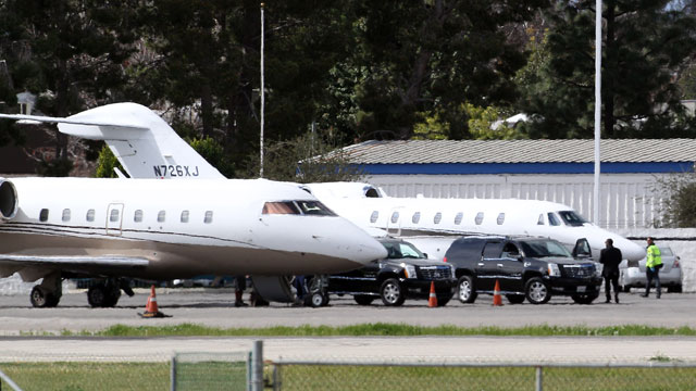 PHOTO: A view of Tyler Perrys private jet (plane on the right) is transporting Whitney Houstons body from California to New Jersey, Feb. 13, 2012. The plane on the left is a private jet taking Whitney Houstons family members back to the East Coast.