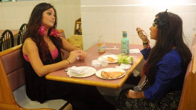 "PHOTO: Jennifer ""JWoww"" Farley sits with Nicole ""Snooki"" Polizzi in a scene from their new reality show."
