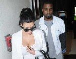 PHOTO: Kim Kardashian and Kanye West arrive at LAX, from Rio after missing the Grammys, Feb. 12, 2013.
