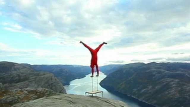 VIDEO: Eskil Ronningsbakken does a handstand 2,000 feet in the air without a harness or safety net.