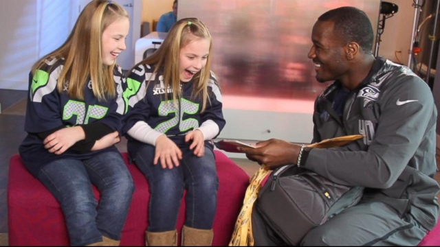 VIDEO: The Seattle Seahawks running back surprised his two biggest fans with tickets to the Super Bowl.