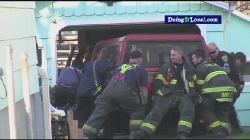 VIDEO: Firefighters Lift Car to Save Man