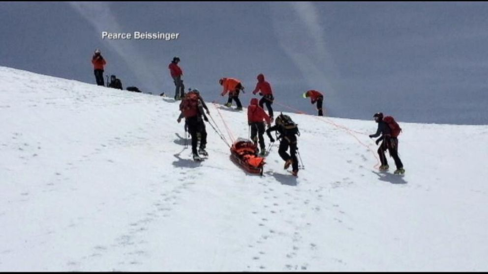 VIDEO: A mountain climber was saved after plummeting hundreds of feet down a slope.