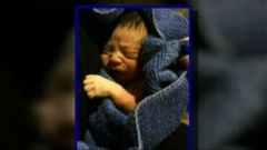 VIDEO: A church custodian found the baby wrapped in cloths and with his umbilical cord still attached.