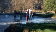VIDEO: Robert Doidge, 78, was pulled from the pond by divers but died on the way to the hospital.
