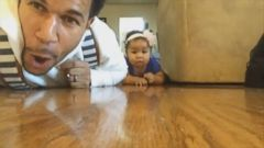 "VIDEO: Aaron Whites ""Lets Crawl"" rap got his 10-month-old daughter crawling across the living room."