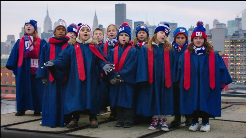 VIDEO: Choruses of kids born 9 months after the Super Bowl sing Seals Kissed from a Rose.