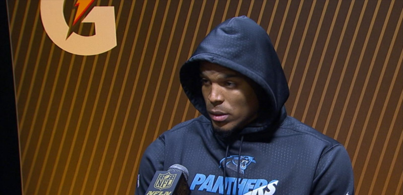 VIDEO: A Broncos player could be heard boasting about his team's win as the Carolina Panthers quarterback was answering questions from reporters.