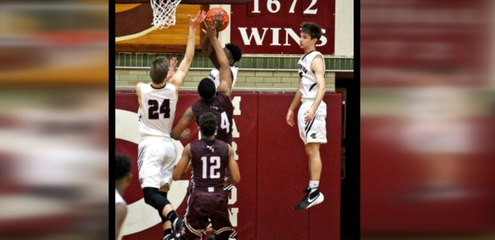VIDEO: A photo of Champaign Central High School junior Walker Stillman in mid-air a during basketball game is going viral.
