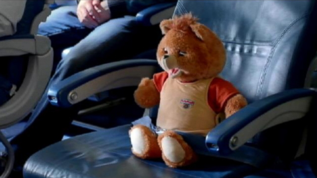 VIDEO: Hair scrunchies, leg warmers and Teddy Ruxpin are all part of this in-flight video.