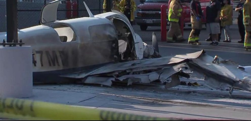 VIDEO: Eyewitnesses jump into action after a small plane makes a crash landing in San Diego parking lot.
