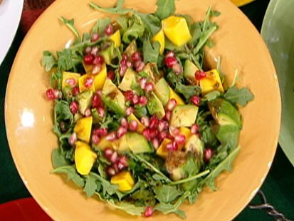 Diane Henderiks arugula, papaya and avocado salad with pomegranate-lime vinaigrette is shown.