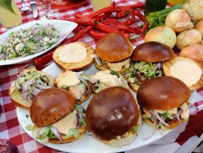 PHOTO:??Carla Hall prepares a delicious burger for Labor Day.