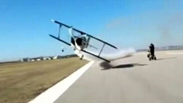 VIDEO: A viral video shows a plane barely 2 feet off the ground zooming right by a man on an ATV.