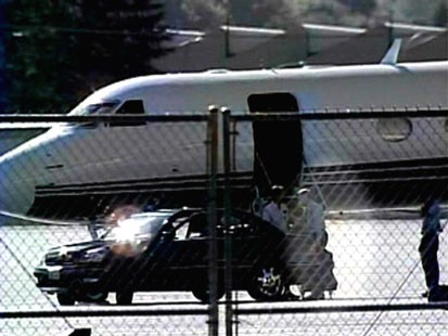A picture of an automotive executive getting off of a private jet.