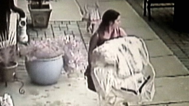 VIDEO: Bride-to-be stages brazen robbery with bridesmaids at bridal boutique.