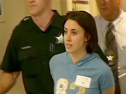 A picture of Casey Anthony in handcuffs.
