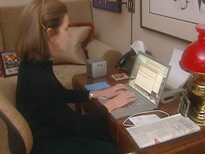 VIDEO: A woman typing at a desk.