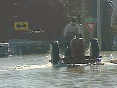 VIDEO: A tractor driving through a flooded street.