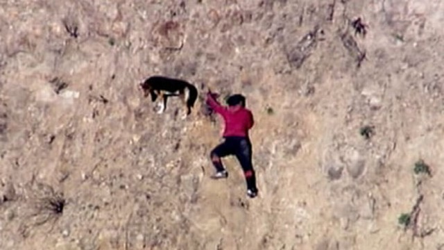 VIDEO: Ivan Salas needed help after attempting to save his dog from falling off cliff.