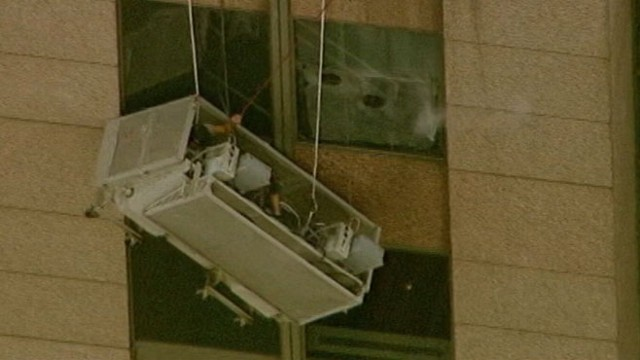VIDEO: The two workers were stuck hanging from the 42nd floor for one hour.