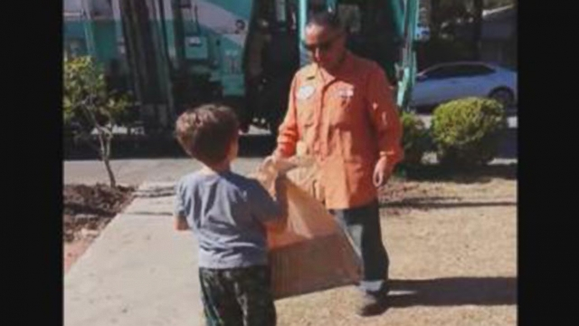 VIDEO: Garbage Collector Delivers Special Toy