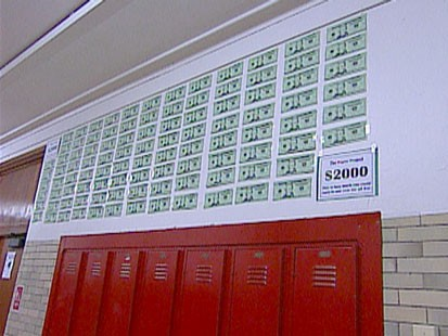 A picture of money above lockers.