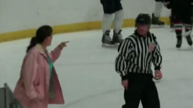 VIDEO: Gina OToole charged the ice after her son joined a fight during a hockey game.
