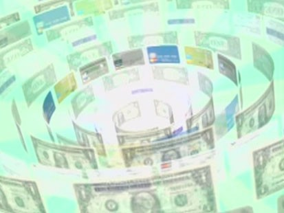 An image of swirling credit cards and dollars.