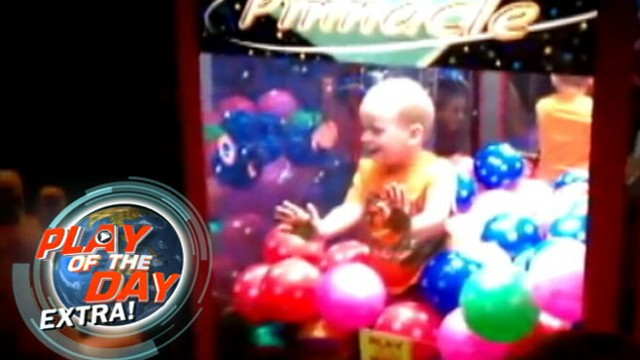 VIDEO: A curious toddler climbed his way into the claw game at a local bowling alley.