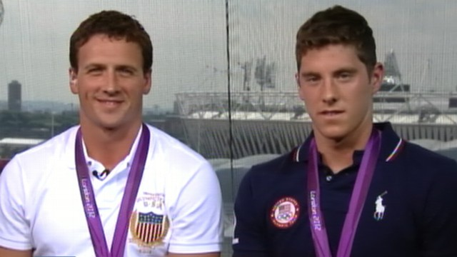 VIDEO: Gold medalist joins fellow athletes in capitalizing on their first-place finishes.