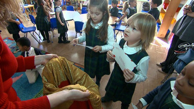 VIDEO: A class of first-graders writes letters to Santa to help make sick childrens dreams come true.
