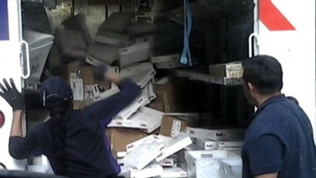 VIDEO: A video uploaded to YouTube shows Manhattan employees throwing boxes onto a truck.
