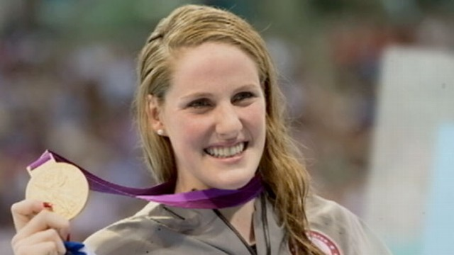 VIDEO: The 17-year-old swimmer dedicated her gold medal win to the shooting victims in her home town.