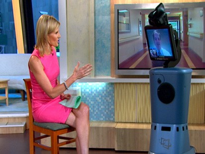 PHOTO Good Morning America Weekend anchor meets with neurologist Dr. Paul Vespa of the Ronald Reagan UCLA Medical Center using the RP7i robot.