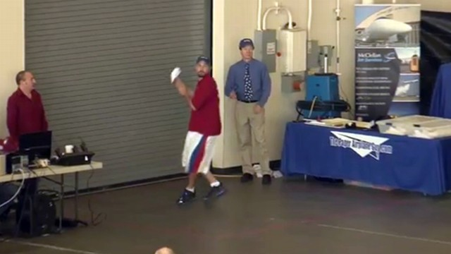 VIDEO: Joe Ayoob threw a specially-designed paper airplane 226 feet, 10 inches.