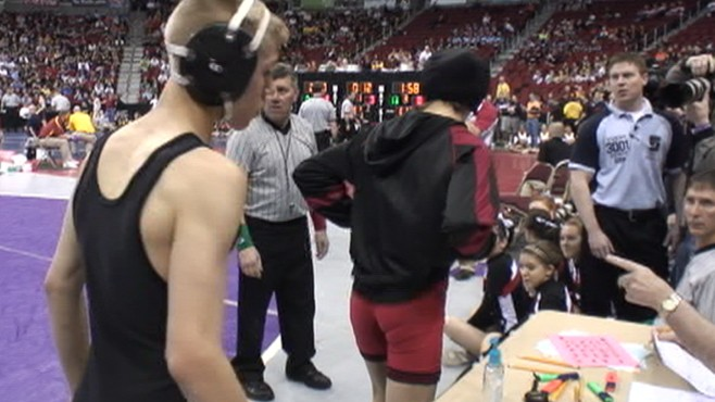 VIDEO: Iowa high school wrestler forfeits match rather than face female opponent.