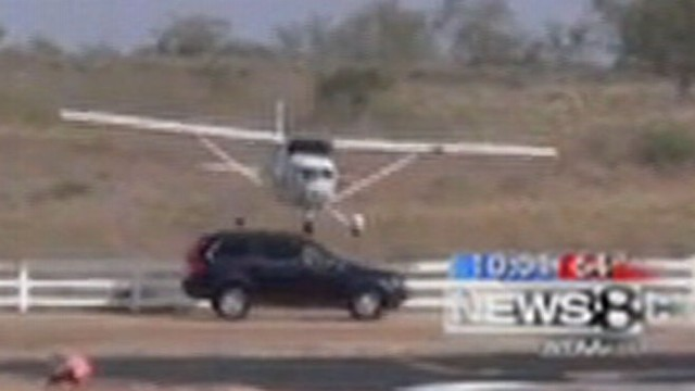 VIDEO: SUV Clipped by Incoming Airplane