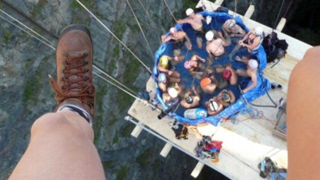 VIDEO: Photos show a group of people in hot tub suspended from a bridge.