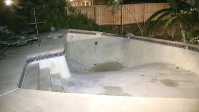 VIDEO: Hole Swallows Florida Pool