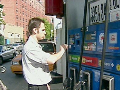 A picture of a man paying for gas.
