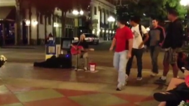 VIDEO: Singer draws a big crowd on San Diego street but an even bigger audience online.