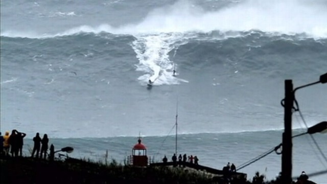 VIDEO: Carlos Burle may have made history by riding the biggest wave on record.